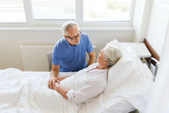 Senior couple meeting at hospital ward Stock Image