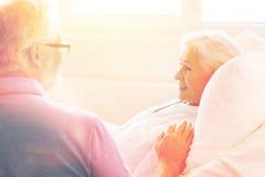 Senior couple meeting at hospital ward royalty free stock photo