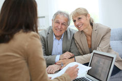 Senior couple meeting with real estate agent stock image