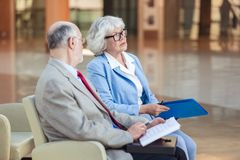 Senior couple at meeting stock images