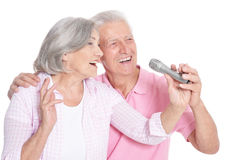 Senior couple with microphone Stock Images
