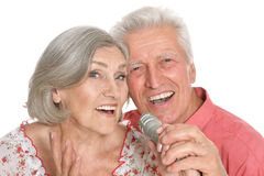 Senior couple with microphone. Portrait of a senior couple and microphone Stock Photography