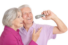 Senior couple with microphone Royalty Free Stock Images