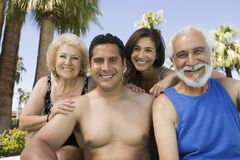 Senior couple and mid-adult couple outdoors front view portrait. Royalty Free Stock Image