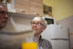 Senior couple morning in kitchen royalty free stock image