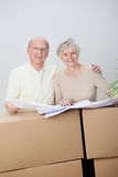 Senior couple moving home planning their future Royalty Free Stock Photos