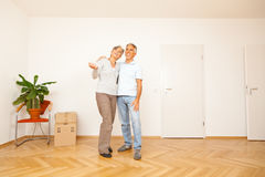 Senior Couple Moving Into A New Apartment Royalty Free Stock Image