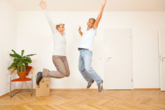 Senior Couple Moving Into A New Apartment Stock Photography