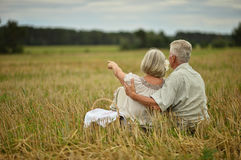 Senior couple on mowed field of wheat Stock Image