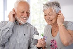 Senior couple with mp3 player Stock Photo