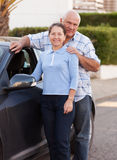 Senior couple near car. Stock Image