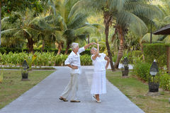 Senior couple near hotel resort Stock Images