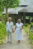 Senior couple near hotel resort Stock Images