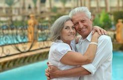 Senior couple near pool Royalty Free Stock Photos