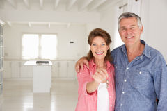 Senior couple in new home stock photography