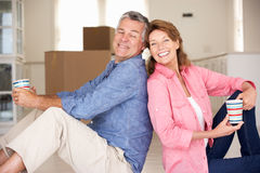 Senior couple in new home stock photos