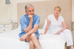 Senior couple not speaking after an argument on bed Royalty Free Stock Images