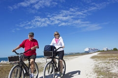 Senior Couple On A Bike Ride While On Cruise Vacation Royalty Free Stock Photos