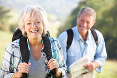 Free Senior Couple On Country Walk Stock Images - 25391514