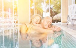 Free Senior Couple On Wellness Vacation In The Pool Stock Photos - 121670283