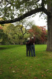Senior Couple out for a Stroll. In nature in the autumn i n New England Stock Image