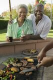 Senior Couple at outdoor barbecue portrait. Royalty Free Stock Photo