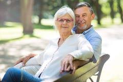Senior Couple Outdoors. Loving senior couple smiling outdoors Stock Photo