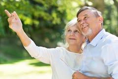 Senior Couple Outdoors. Loving senior couple smiling outdoors Stock Image