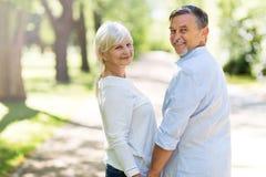 Senior Couple Outdoors. Loving senior couple smiling outdoors Royalty Free Stock Image