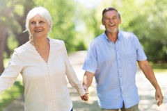 Senior Couple Outdoors. Loving senior couple smiling outdoors Stock Photography