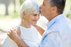 Senior Couple Outdoors. Loving senior couple smiling outdoors Stock Photos