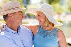 Senior Couple Outdoors. Loving Senior Couple Outdoors Smiling Stock Photo