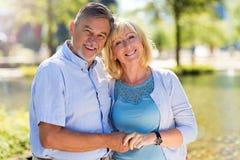 Senior Couple Outdoors. Loving Senior Couple Outdoors Smiling Royalty Free Stock Images