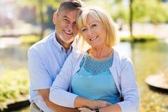 Senior Couple Outdoors. Loving Senior Couple Outdoors Smiling Royalty Free Stock Image