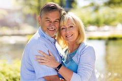 Senior Couple Outdoors. Loving Senior Couple Outdoors Smiling Stock Images