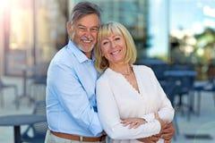 Senior Couple Outdoors. Loving Senior Couple Outdoors Smiling Stock Image
