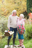 Senior Couple Outdoors With Picnic Basket royalty free stock photography