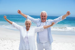 Senior couple outstretching their arms Royalty Free Stock Photography