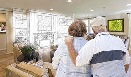 Senior Couple Over Custom Living Room Design Drawing and Photo Stock Photos