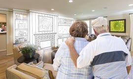 Senior Couple Over Custom Living Room Design Drawing and Photo. Senior Couple Looking Over Custom Living Room Design Drawing and Photo Combination Stock Photos