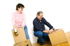 Senior couple packing boxes Royalty Free Stock Photos
