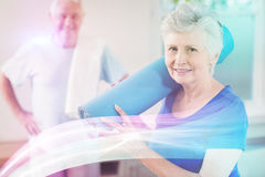 Senior couple packing up after workout. Senior woman smiling while packing up after workout Stock Photography