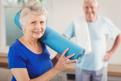 Senior couple packing up after workout Stock Photos