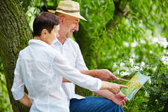 Senior couple painting in nature in summer Stock Photography