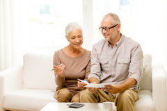 Senior couple with papers and calculator at home Stock Image