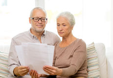 Senior couple with papers at home Stock Photos