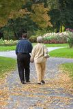 Senior Couple in Park. Senior Couple Walking in the Park Royalty Free Stock Photos