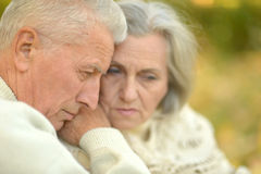 Senior couple in park. Sad Senior couple resting at autumn park Royalty Free Stock Images