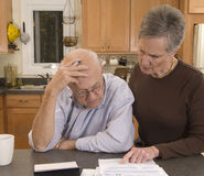 Senior couple paying bills Royalty Free Stock Photos