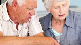 Senior couple paying their bills Stock Photo
